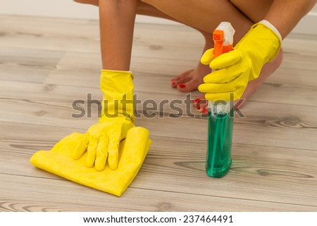cleaning  parquet in yellow gloves - stock photo