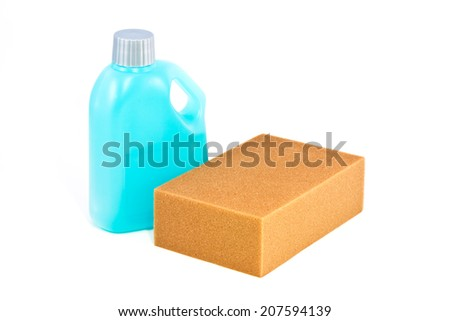 Cleaning product, Blue plastic bottle and sponge on white background - stock photo