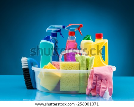 cleaning products and supplies in basket - stock photo