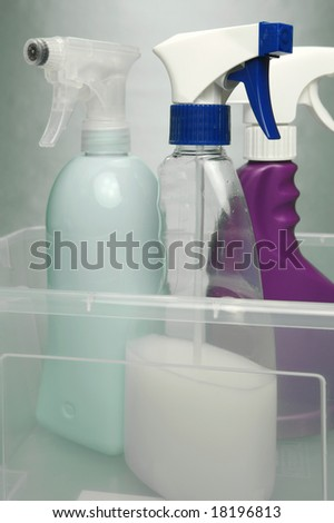 Cleaning products isolated against a green background