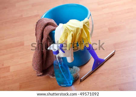 cleaning products on wooden floor - stock photo
