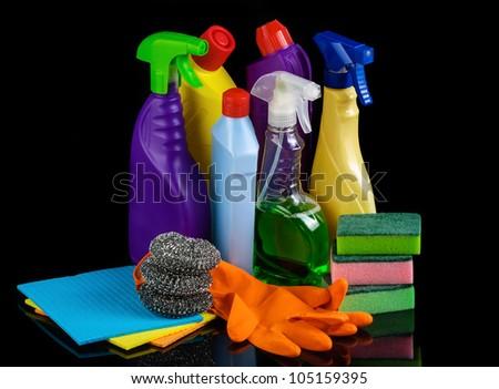 Cleaning set on black background - stock photo