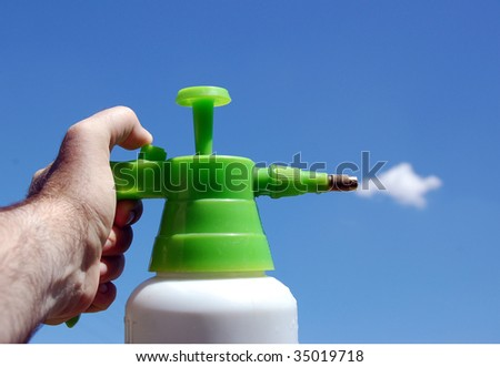 Cleaning sky. Sprayer and cloud. Fun. - stock photo