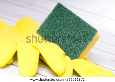 Cleaning sponge and gloves / housecleaning - stock photo
