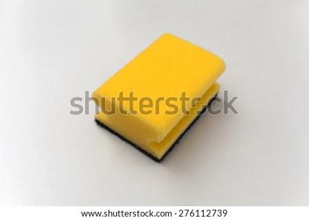 Cleaning sponge on white background - stock photo