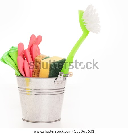 Cleaning sponges in a silver pail isolated on a white background - stock photo