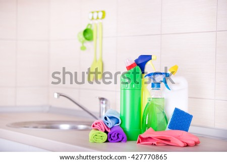 Cleaning supplies and equipment on the kitchen countertop