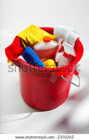 Cleaning supplies in a red bucket