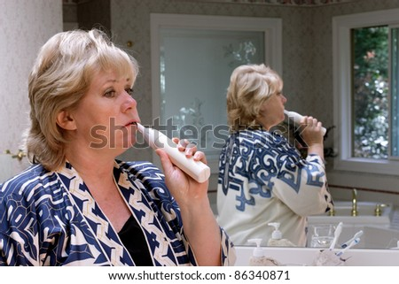 Cleaning teeth - stock photo