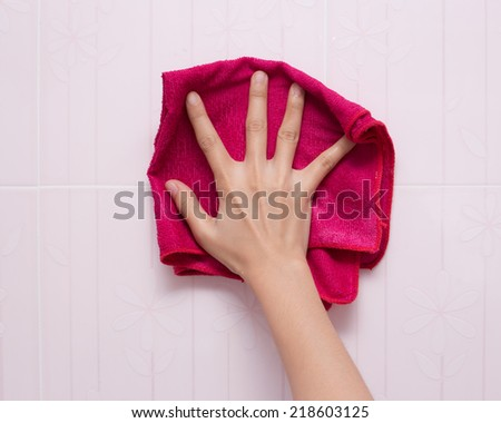 cleaning the bathroom tiles. - stock photo