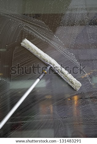 Cleaning the outdoor of a building window.