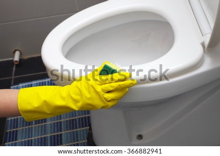 cleaning the toilet closeup - stock photo