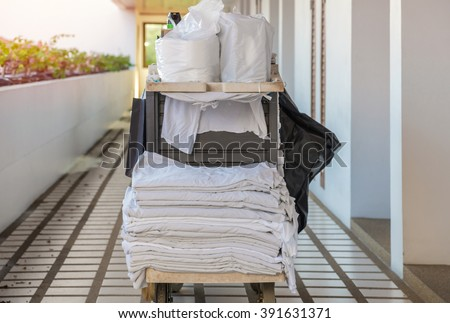 cleaning tool cart of housekeeper or maid in hotel. - stock photo