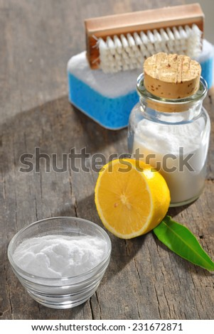 cleaning tools with lemon and sodium bicarbonate on wood - stock photo