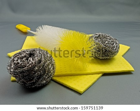 Cleaning utensils in yellow.  - stock photo