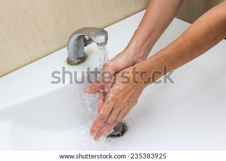 cleaning : Washing hands with soap under running water - stock photo