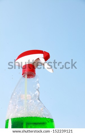 Cleaning window using tool spray detergent. Spring cleaning concept - stock photo