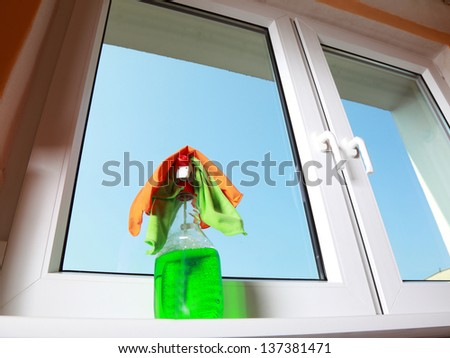 Cleaning window using tools - rag and spray detergent. Spring cleaning concept - stock photo