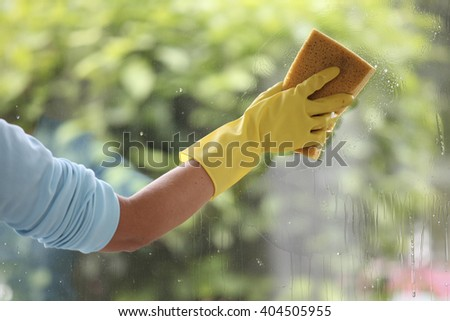 Cleaning windows with a sponge - stock photo