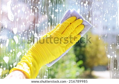 Cleaning windows with special rag  - stock photo