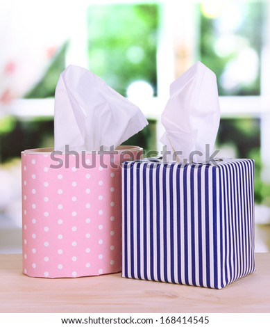 Cleaning wipes on window background - stock photo
