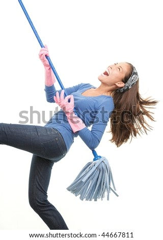 Cleaning woman having fun by playing air guitar with the mop. Isolated on white background.