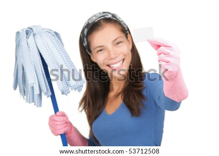 Cleaning woman holding white sign or business card with copy-space. Isolated on white background. Shallow depth of field, focus on sign. - stock photo