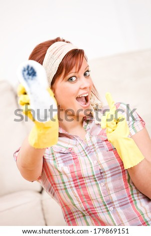 Cleaning: Woman Holds Out Scrub Brush