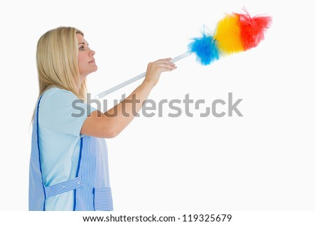 Cleaning woman using a feather duster in the white background - stock photo