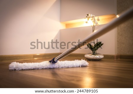 Cleaning wooden floor - stock photo