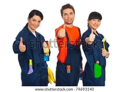Cleaning workers in a row holding cleaning products and giving thumbs up isolated on white background - stock photo