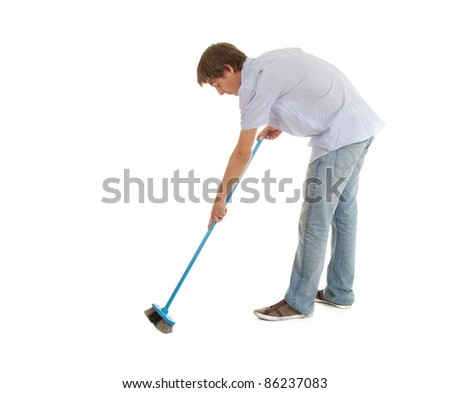 cleaning young man with blue sweep brush - stock photo