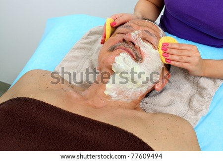 Cleansing facial mask. Intentional shallow depth of field. - stock photo