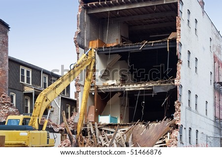 Cleanup after Unplanned Building Collapse - stock photo