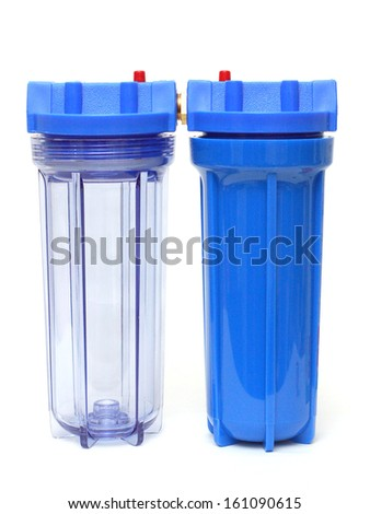 Clear and Blue Coupled Water Filter Housing on Isolated White Background - stock photo