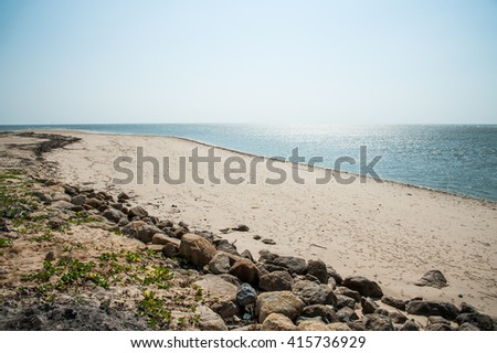 Clear beach and rock defend wave in South of Thailand. - stock photo