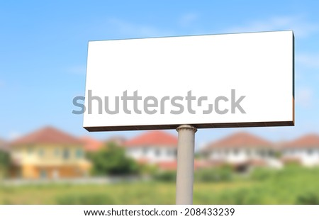 clear billboard for new realty advertisement - stock photo