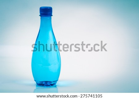 clear blue bottle with clear water - stock photo