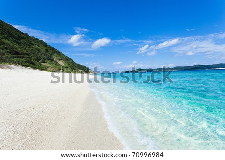 Clear blue coral water lapping white sand tropical beach on the deserted island, Kerama Islands, Okinawa, Tropical Japan