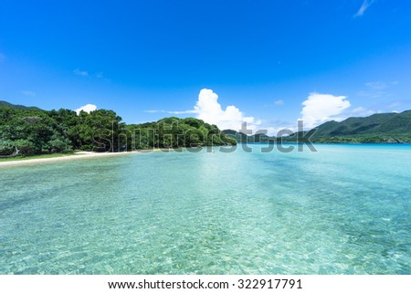 Clear blue lagoon water and tropical paradise beach, Kabira Bay, Ishigaki Island of the Yaeyama Islands, Okinawa, Japan - stock photo