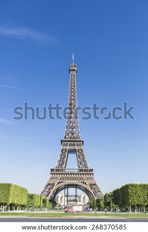 Clear blue sky and Eiffel Tower view. - stock photo