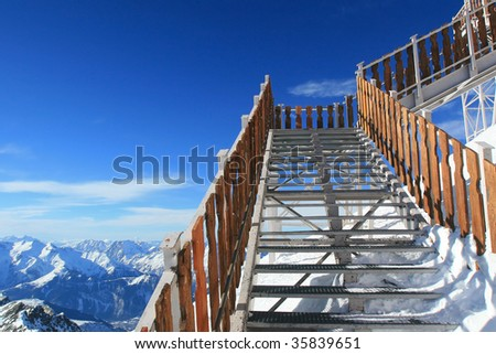 clear blue sky in the french Alps, stairway to the sky, ski resort in the Alps, skiing in France, winter holiday in Europe, alps d'huez, clear blue sky in the winter, mountains covered in snow - stock photo