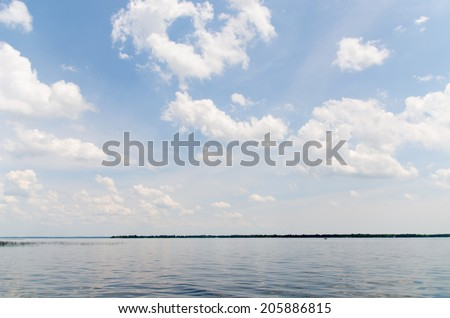Clear Blue Sky on Lake with Clouds - stock photo