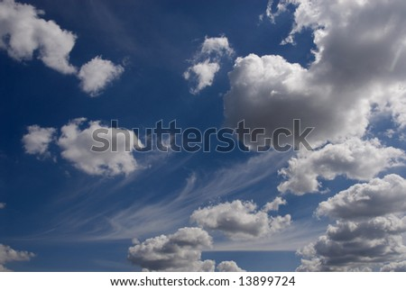 clear blue sky with different clouds - stock photo