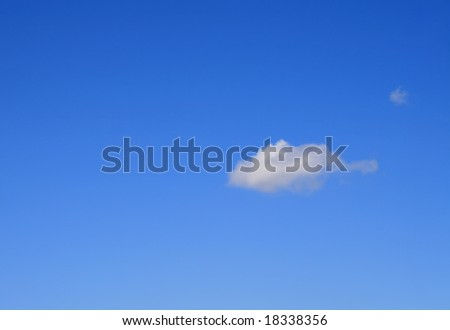 Clear blue sky with one little cloud - stock photo