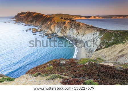 Clear blue water and shoreline - stock photo