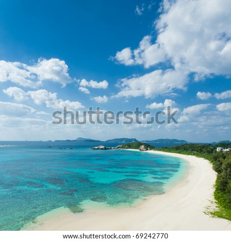 Clear blue water, coral reef and deserted white sand tropical beach of Kerama Islands, Okinawa, Japan - stock photo
