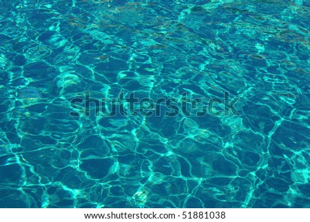 Clear blue water in the swimming pool - stock photo