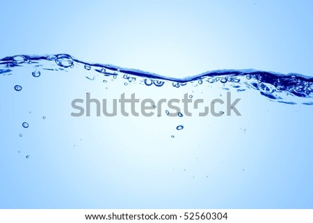 Clear Blue Water Waves and Bubbles - stock photo