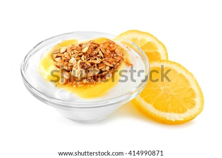 Clear bowl of lemon flavored yogurt and granola with lemon slices over a white background - stock photo